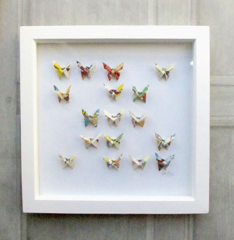 A wall of #origami #butterflies brightens up the room! http://www ... | 800x779
