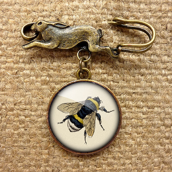 Similar. Yes, vintage bee pin Exaggerate